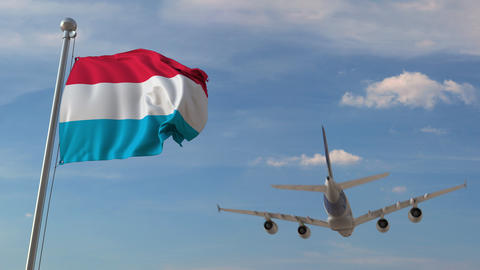 Airplane flying over flag of Luxembourg. Luxembourgian tourism related 3D Live Action