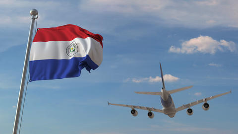 Airliner passing above national flag of Paraguay. Paraguayan air transportation Live Action