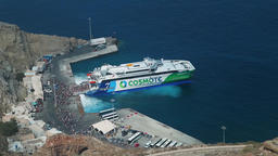 arriving to Santorini port. Passenger ferry boat with tourists. Large croud of tourists Live Action
