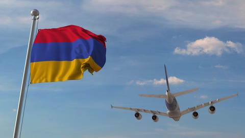 Airliner passing above national flag of Armenia. Armenian air transportation Live Action