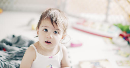 Incredible cute baby girl playing indoors Footage