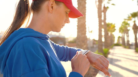 Smartwatch. Woman using smart watch. Closeup of female touching touch screen on Footage