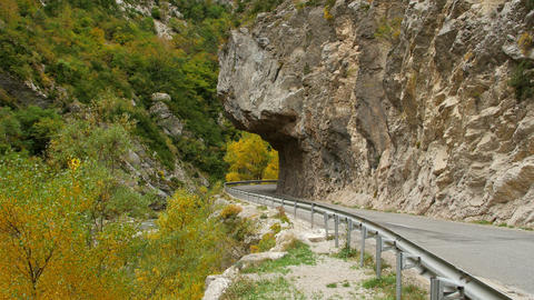 Dangerous asphalt mountain road in France, cars can barely pass each other Live Action