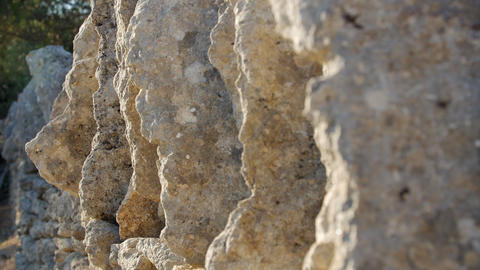 The texture of the stone wall of the sharp cracked convex rough natural puff of Footage