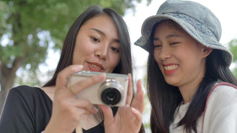 Slow motion Happy Young Asian Couple Smiling And Taking Selfie Photo To The Camera, LGBT Lesbian Live Action