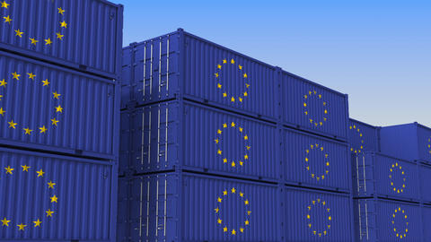Container yard full of containers with flag of the European Union. The EU export Live Action