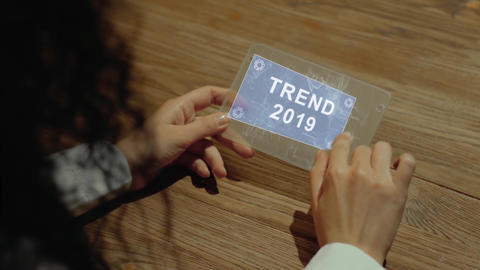 Hands hold tablet with text Trend 2019 Footage