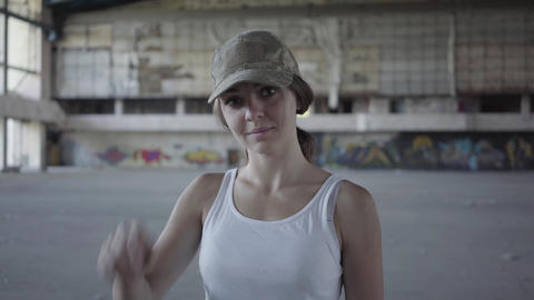 Portrait of attractive young woman touching her military cap on her head and Footage