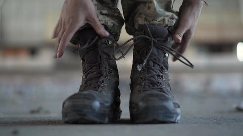 Close-up of female hands lacing up her old shoes getting ready for training Footage