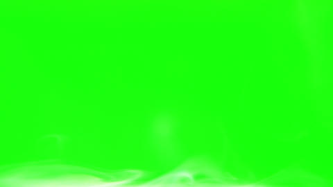 white smoke moves from left to right on the bottom of the frame green screen Footage