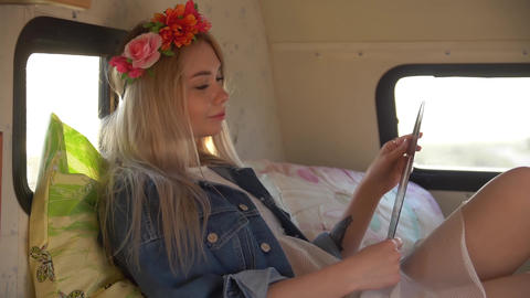 a young woman with a wreath of flowers on her head is lying on a sofa in an Live Action