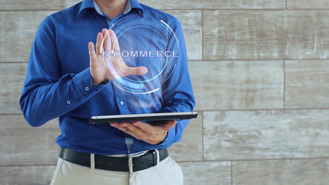 Man uses hologram with text E-commerce Live Action