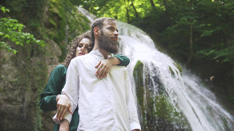 touching embrace of an attractive woman and a man with a beard on the background Footage