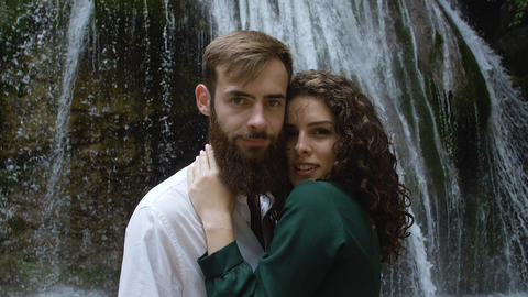 beautiful couple in love man with beard and woman with curly hair on the Footage