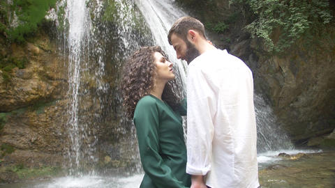 lovers young beautiful man and woman look at each other against the backdrop of Footage