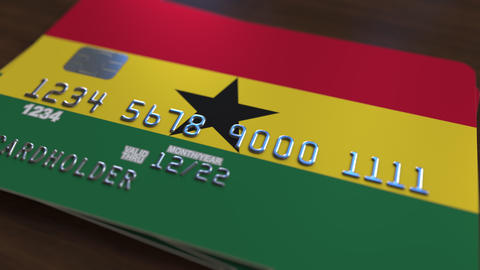 Plastic bank card featuring flag of Ghana. Ghanaian national banking system Footage