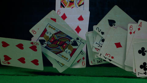 Game cards falling down on green table Animation