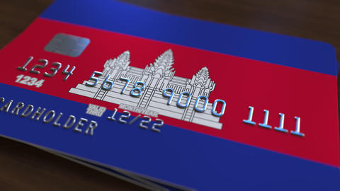 Plastic bank card featuring flag of Cambodia. Cambodian national banking system Footage