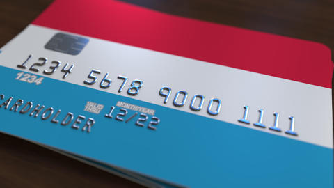 Bank card featuring flag of Luxembourg. Luxembourgian national banking system Footage