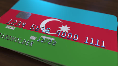 Plastic bank card featuring flag of Azerbaijan. Azerbaijani national banking Footage