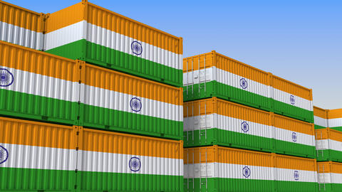 Container terminal full of containers with flag of India. Indian export or Live Action