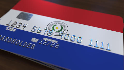 Plastic bank card featuring flag of Paraguay. Paraguayan national banking system Live Action