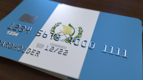 Bank card featuring flag of Guatemala. Guatemalan national banking system Live Action