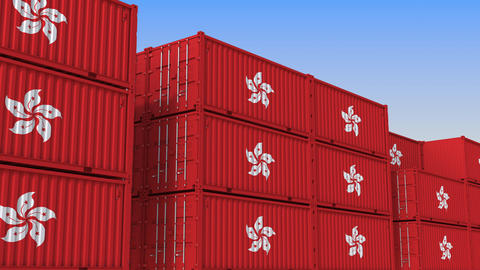 Container terminal full of containers with flag of Hong Kong. Export or import Live Action