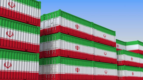Container terminal full of containers with flag of Iran. Iranian export or Live Action