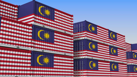 Container terminal full of containers with flag of Malaysia. Malaysian export or Live Action