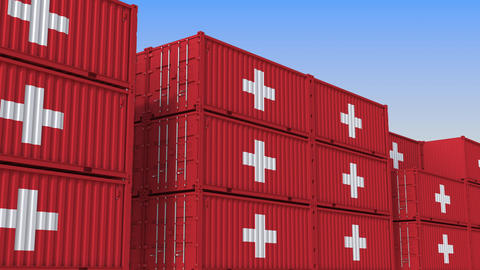 Container terminal full of containers with flag of Switzerland. Swiss export or Live Action