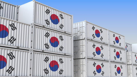 Container terminal full of containers with flag of South Korea. Korean export or Live Action