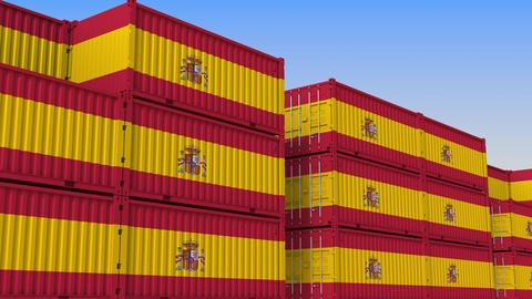 Container yard full of containers with flag of Spain. Spanish export or import Live Action