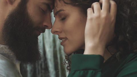 profile portrait of a man with a beard and a woman with eyes closed who bent Footage