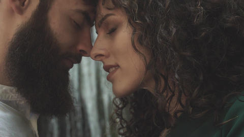 two profiles of a man and a woman who are smiling against the backdrop of a Footage