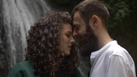 young couple attractive man with a beard and a charming woman with curly hair Footage