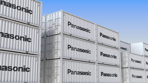 Container terminal full of containers with logo of Panasonic. Shipment, export Live Action