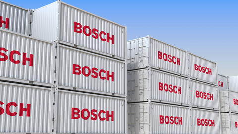 Container yard full of containers with logo of Bosch. Shipment, export or import Live Action