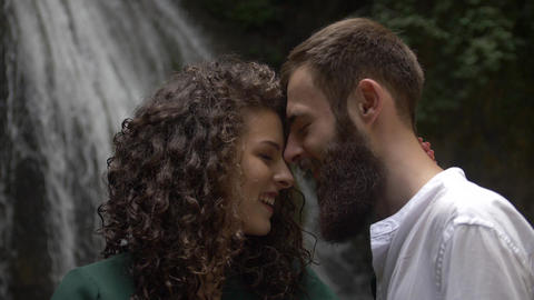 just married attractive man with a beard and a charming woman with curly hair Footage