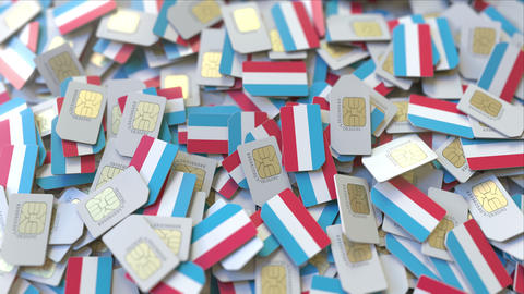 Many SIM cards with flag of Luxembourg. Luxembourgian mobile telecommunications ビデオ