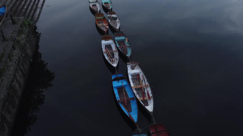 JSP-0722 Row boats mored on river early morning still water Live Action