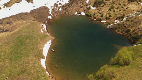 Aerial view from above flying around. Amazing natural phenomenon mountain lake in form heart. Live Action