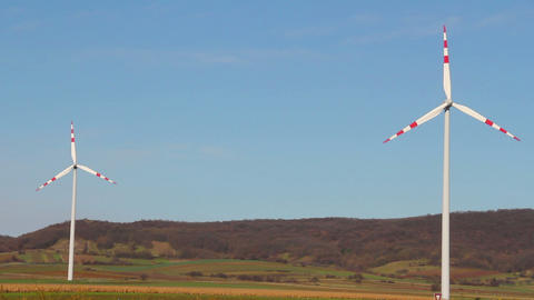 Wind turbine on a blue sky Footage