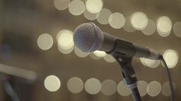 Professional microphone stands on the stage in the light in the great hall Live Action