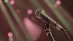 Professional microphone stands on the stage in the light Live Action