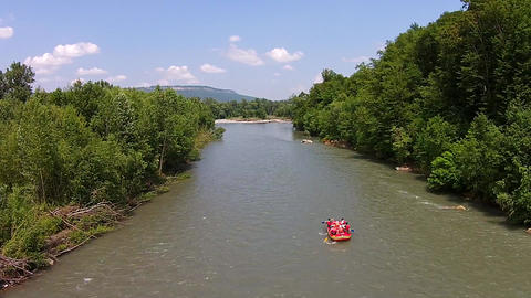 Aerial view of Red boat rafting on the river Live Action