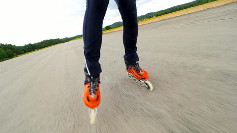 The roller skates in movement. Training of inline skating on concrete surface of abandoned airport Live Action