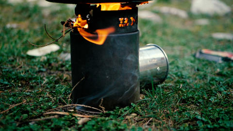Bright fire over a black stove outdoors in slow motion Footage