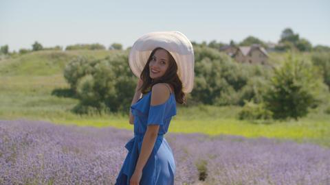 Graceful dreamy female resting in lavender field Footage