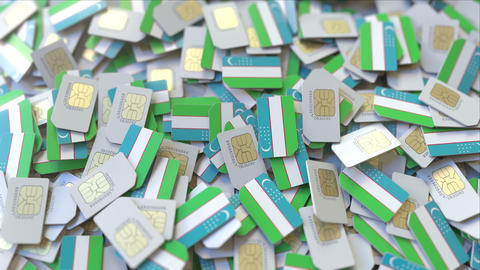 Many SIM cards with flag of Uzbekistan. Uzbek mobile telecommunications related ビデオ